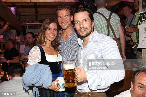 Conny Lehmann, Jens Lehmann and Quirin Berg during the Oktoberfest Opening in Kaeferzelt at Theresienwiese on September 20, 2014 in Munich, Germany.