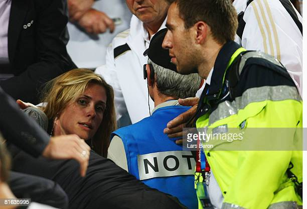 Conny Lehmann , wife of Jens Lehmann of Germany is assisted by medical staff after the UEFA EURO 2008 Quarter Final match between Portugal and...