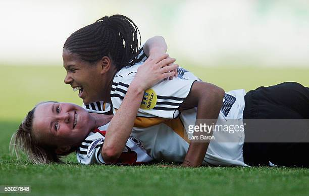 Conny Pohlers from Germany celebrates scoring the first goal with Navina Omilade during the UEFA Women's Championship group B preliminary match...