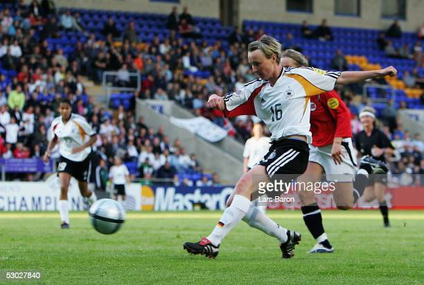 Conny Pohlers from Germany scores the first goal during the UEFA Women's Championship group B preliminary match between Germany and Norway on June 6...