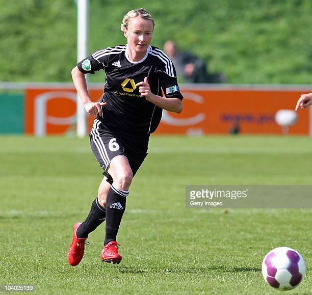 Conny Pohlers of Frankfurt runs with the ball during the Women's bundesliga match between FCR Duisburg and FFC Frankfurt at the PCCStadium on...