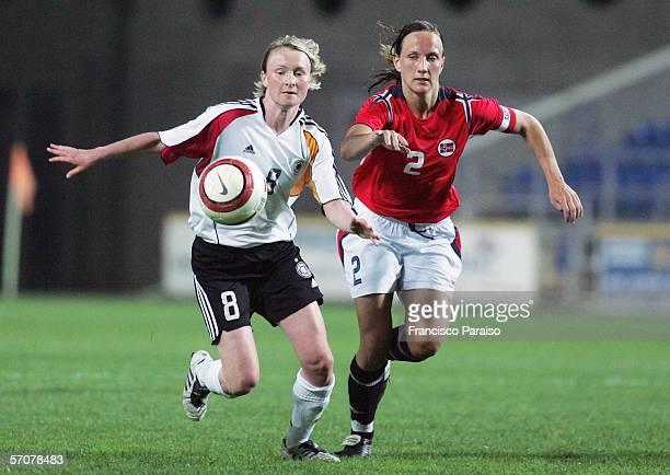 Conny Pohlers of Germany and Ane Stangeland of Norway vie for the ball during the Womens Algarve Cup match between Germany and Norway on March 13,...