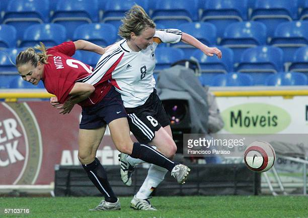Conny Pohlers of Germany is challenged by Heather Mitts of USA during the Womens Algarve Cup match between Germany and USA on March 15, 2006 in Faro,...