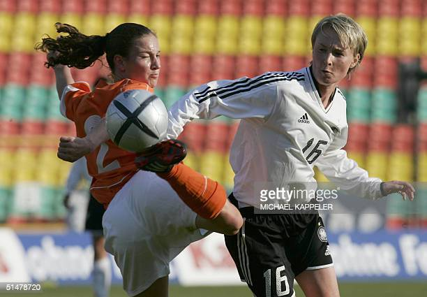 Conny Pohlers of the German women's football national team vies for the ball with Dutch Esther Scheenarard during their friendly match of Germany...