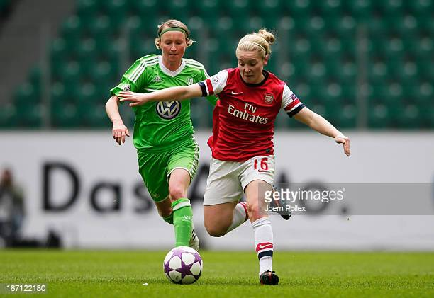 Conny Pohlers of Wolfsburg and Kim Little of Arsenal compete for the ball during the Women's Champions League semifinal second leg match between VfL...