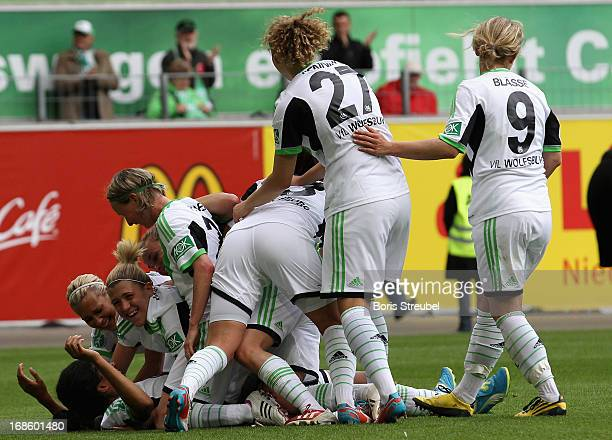 Conny Pohlers of Wolfsburg celebrates her team's third goal with team mates during the Women's Bundesliga match between VfL Wolfsburg and SC Bad...