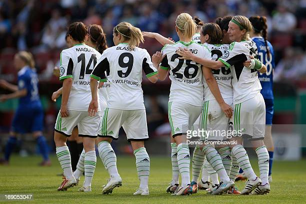 Conny Pohlers of Wolfsburg celebrates with teammates after scoring his team's third goal during the Women's DFB Cup Final between VfL Wolfsburg and 1...