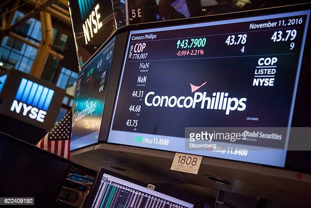 ConocoPhillips Co signage is displayed on the floor of the New York Stock Exchange in New York US on Friday Nov 11 2016 US stocks fluctuated in...