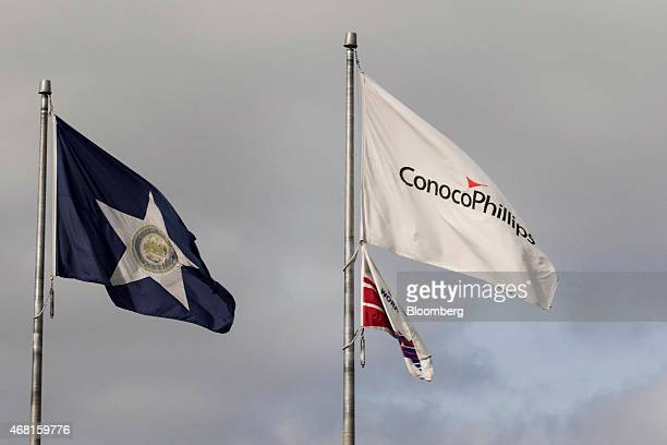 A ConocoPhillips flag flies outside of the company's headquarters in Houston Texas US on Wednesday March 25 2015 ConocoPhillips the thirdlargest US...