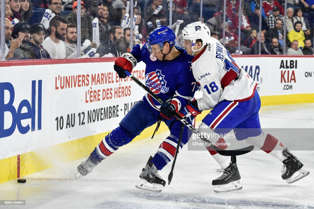 Conor Allen #7 of the Rochester Americans and Martin Reway #18 of the Laval Rocket skate after the puck during the AHL game at Place Bell on October 25, 2017 in Montreal, Laval, Canada. The Rochester Americans defeated the Laval Rocket 5-2.