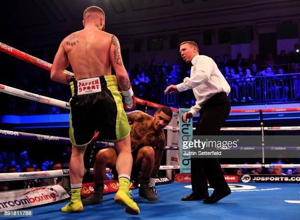 Conor Benn gets knocked down by Cedrick Peynaud during there Welterweight Contest at York Hall on December 13 2017 in London England