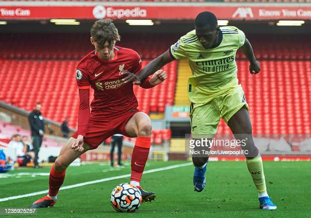 Conor Bradley of Liverpool and Mazeed Ogungbo of Arsenal in action during the PL2 game at Anfield on October 16, 2021 in Liverpool, England.