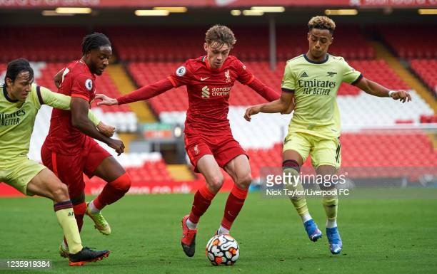 Conor Bradley of Liverpool and Omari Hutchinson of Arsenal in action during the PL2 game at Anfield on October 17, 2021 in Liverpool, England.