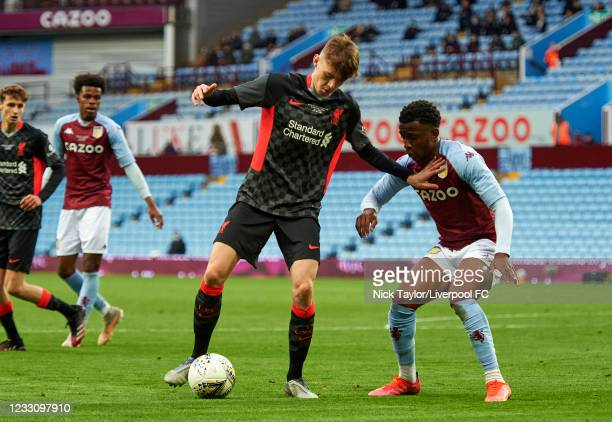 Conor Bradley of Liverpool and Seb Revan of Aston Villa in action during the FA Youth Cup Final between Aston Villa U18 and Liverpool U18, at Villa...
