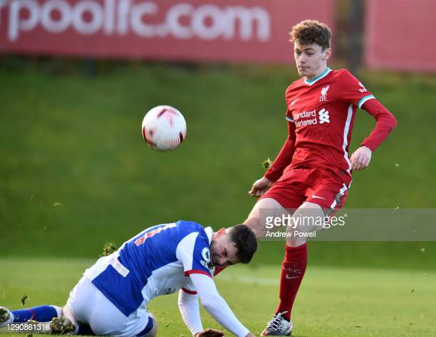 Conor Bradley of Liverpool U23's competing with Samuel Burns of Blackburn Rovers U23 during the Premier League 2 match between Liverpool U23 and...