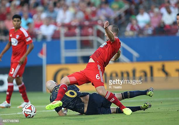 Conor Casey of Philadelphia Union falls forward and trips up Adam Moffat of FC Dallas at Toyota Stadium on July 4 2014 in Frisco Texas