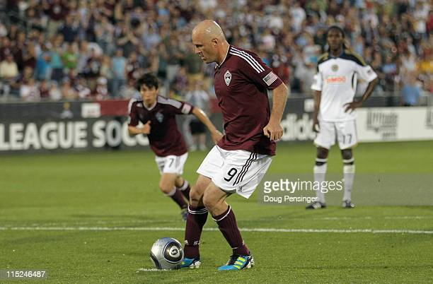 Conor Casey of the Colorado Rapids chips in a penalty shot past goalkeeper Faryd Mondragon of the Philadelphia Union to give the Rapids a 10 lead in...