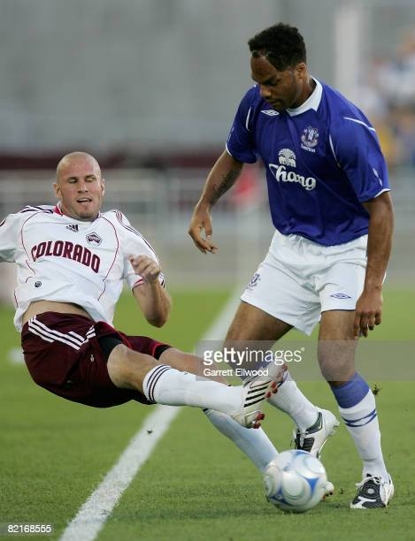 Conor Casey of the Colorado Rapids controls the ball against Joleon Lescott of Everton FC at Dick's Sporting Goods Park on August 3, 2008 in Commerce...