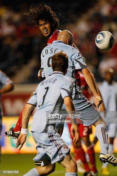 Conor Casey of the Colorado Rapids heads the ball past Wilman Conde of the Chicago Fire to score a goal in front of teammate Drew Moor in an MLS...