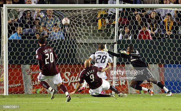 Conor Casey of the Colorado Rapids scores in the first half against goalkeeper Donovan Ricketts of the Los Angeles Galaxy during the MLS match at The...