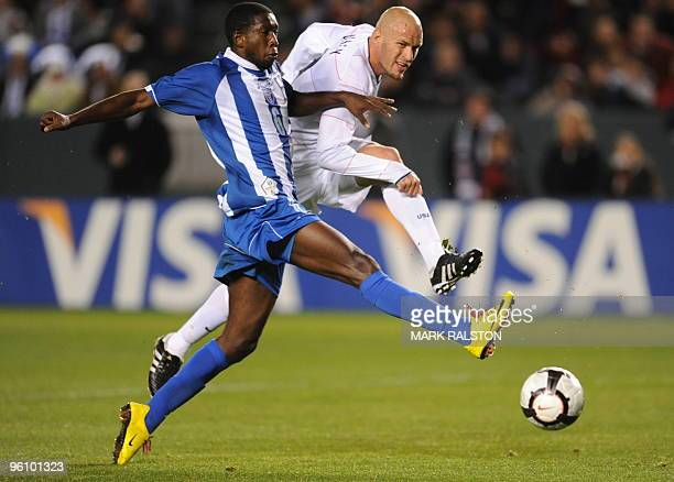 Conor Casey of the US clashes with Johnny Palacios of Honduras during their international friendly at the Home Depot Center Stadium in Los Angeles on...