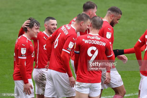 Conor Chaplin of Barnsley celebrates with Callum Styles and team mates after scoring their side's second goal during the Sky Bet Championship match...