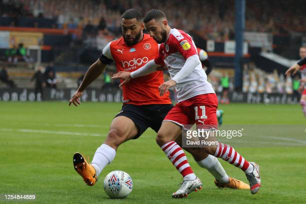 Conor Chaplin of Barnsley is challenged by Cameron Carter-Vickers of Luton Town during the Sky Bet Championship match between Luton Town and Barnsley...