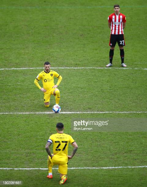 Conor Chaplin of Barnsley takes the knee, as Vitaly Janelt of Brentford stands before kick off, before the Sky Bet Championship match between...