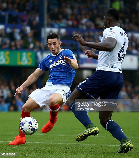 Conor Chaplin of Portsmouth and Aaron Pierre of Wycombe challenge for the ball during the Sky Bet League Two match between Portsmouth and Wycombe...
