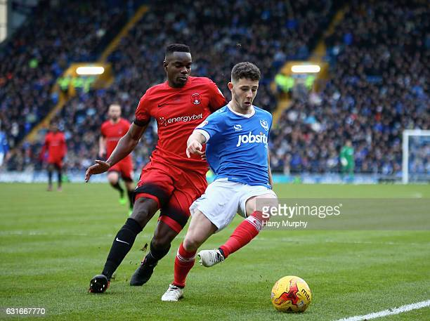 Conor Chaplin of Portsmouth is chassed down by Teddy Mezague of Leyton Orient during the Sky Bet League Two match between Portsmouth and Leyton...
