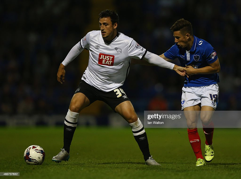 Conor Chaplin of Portsmouth tries to tackle George Thorne of Derby County during the Capital One Cup First Round match between Portsmouth v Derby County at Fratton Park on August 12, 2015 in Portsmouth, England.