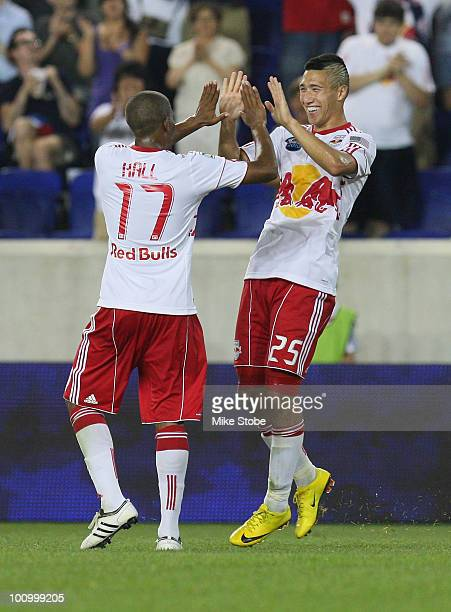 Conor Chinn of the New York Red Bulls celebrates his secondhalf goal with teammate Jeremy Hall against the Colorado Rapids during the US Open Cup...