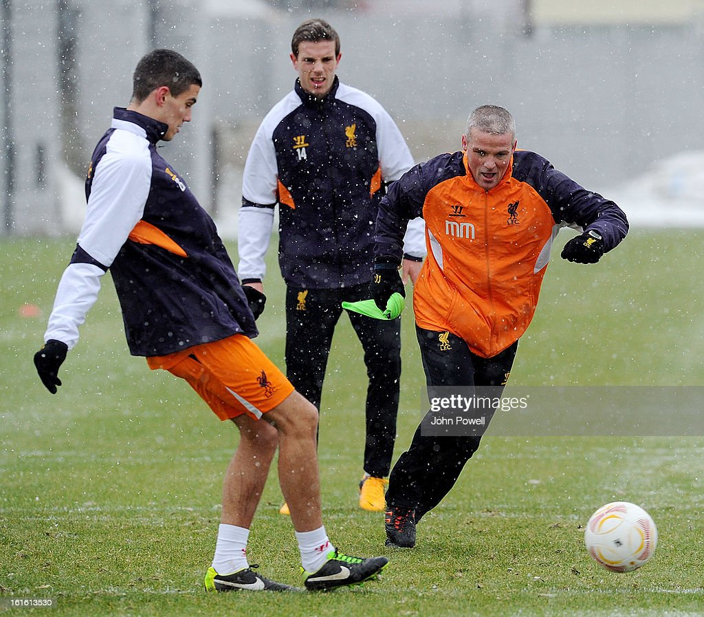 Conor Coady and Mike Marsh first team coach of Liverpool in action during a training session at Melwood Training Ground on February 13, 2013 in Liverpool, England.