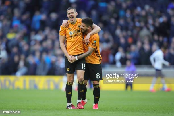 Conor Coady and Ruben Neves of Wolverhampton Wanderers celebrate winning the game at full time after the Premier League match between Tottenham...