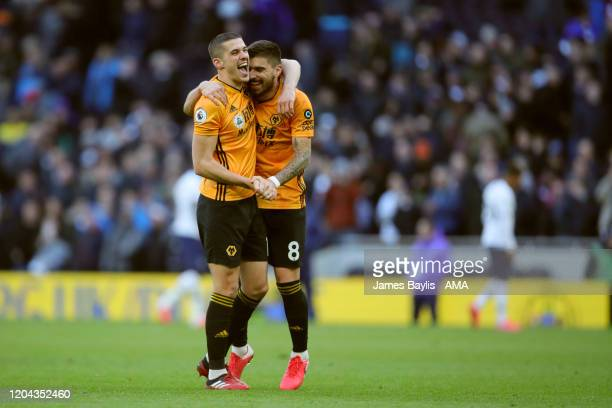 Conor Coady and Ruben Neves of Wolverhampton Wanderers celebrate winning the game at the final whistle after the Premier League match between...