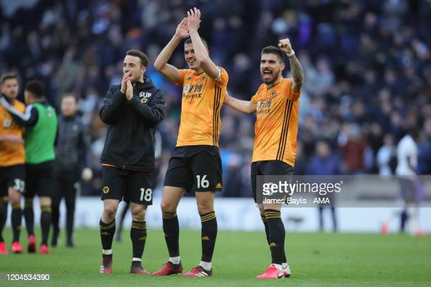 Conor Coady and Ruben Neves of Wolverhampton Wanderers celebrate winning the match at full time during the Premier League match between Tottenham...