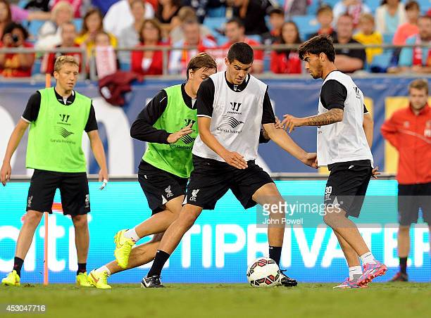 Conor Coady and Suso of Liverpool in action during a open training session at Bank Of America Stadium on August 1 2014 in Charlotte North Carolina