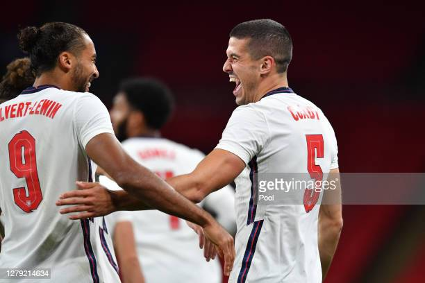 Conor Coady of England celebrates with Dominic Calvert-Lewin of England after scoring his team's second goal during the international friendly match...
