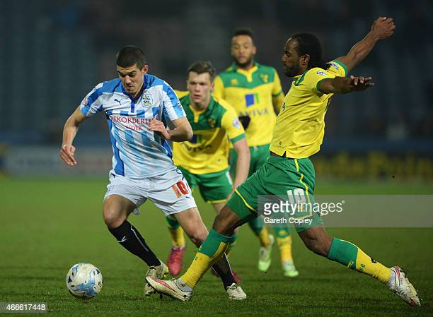 Conor Coady of Huddersfield Town takes on Cameron Jerome of Norwich City during the Sky Bet Championship match between Huddersfield Town and Norwich...