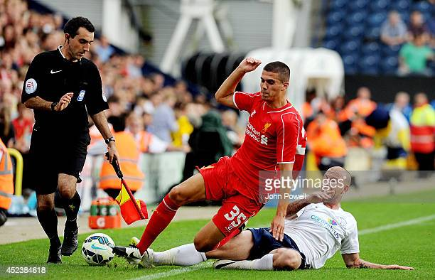 Conor Coady of Liverpool competes with Jack King of Preston North End during the Pre Season friendly match between Preston North End and Liverpool at...
