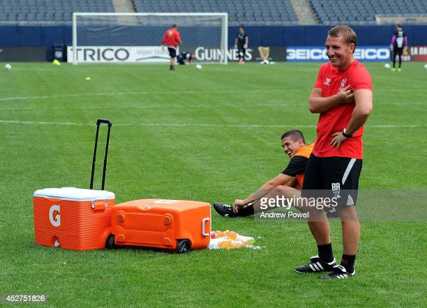 Conor Coady of Liverpool laughing with Brendan Rodgers manager of Liverpool during a training session before the first game in the Guinness...