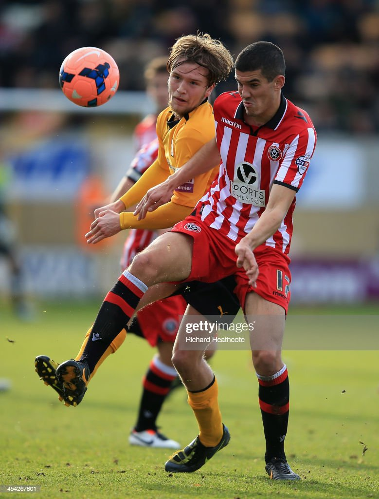 Conor Coady of Sheffield United is challenged by Luke Berry of Cambridge United during the FA Cup Second Round match between Cambridge United and Sheffield United at the Abbey Stadium on December 8, 2013 in Cambridge, Cambridgeshire.