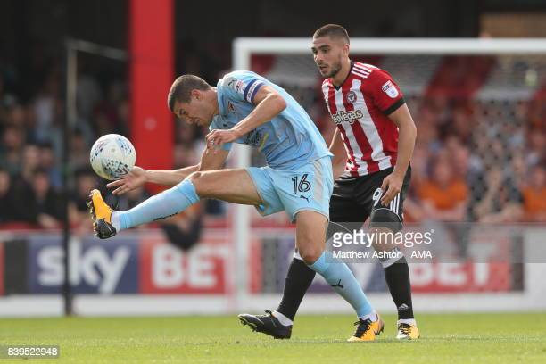 Conor Coady of Wolverhampton Wanderers and Neal Maupay of Brentford during the Sky Bet Championship match between Brentford and Wolverhampton...