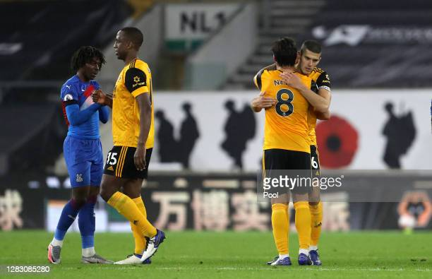 Conor Coady of Wolverhampton Wanderers and Ruben Neves of Wolverhampton Wanderers celebrate following their team's victory in the Premier League...
