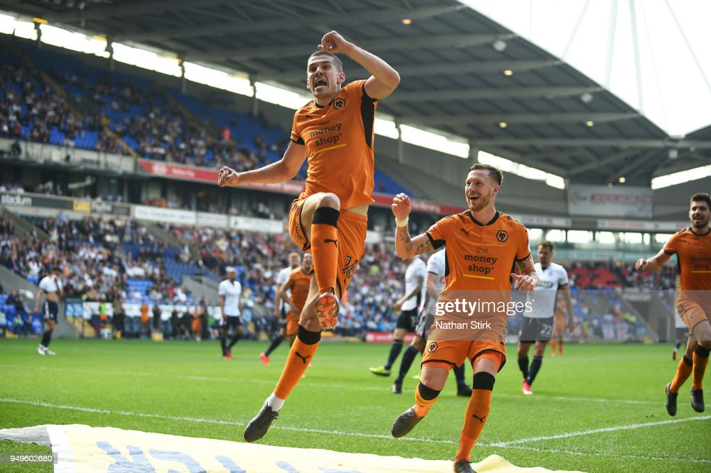 Conor Coady of Wolverhampton Wanderers celebrates after scoring a penalty during the Sky Bet Championship match between Bolton Wanderers and Wolverhampton Wanderers at Macron Stadium on April 21, 2018 in Bolton, England.
