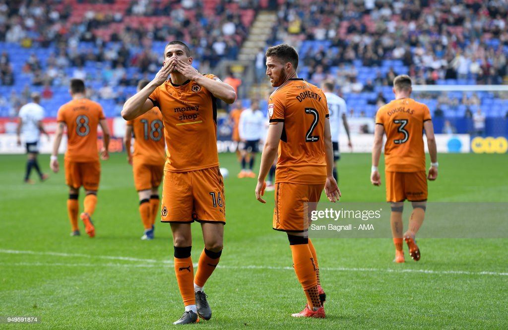 Conor Coady of Wolverhampton Wanderers celebrates after scoring a goal to make it 0-4 from a penalty kick during the Sky Bet Championship match between Bolton Wanderers and Wolverhampton Wanderers at Macron Stadium on April 21, 2018 in Bolton, England.