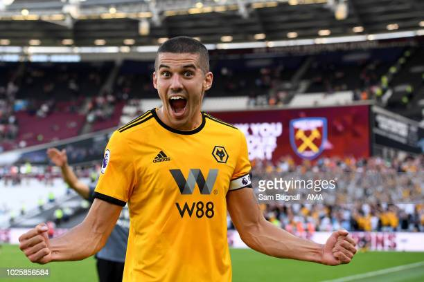 Conor Coady of Wolverhampton Wanderers celebrates at full time during the Premier League match between West Ham United and Wolverhampton Wanderers at...