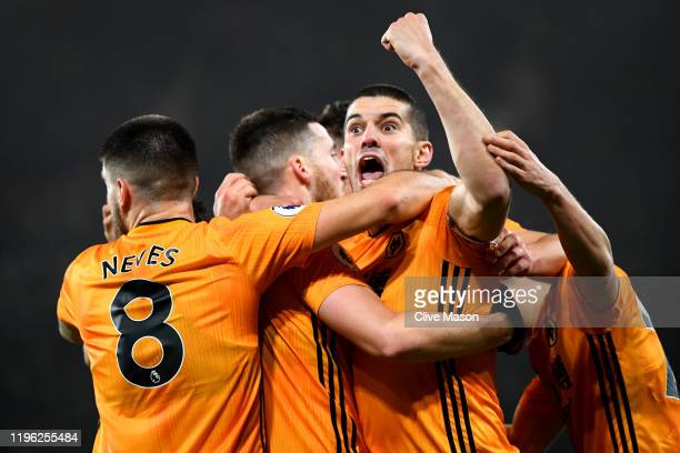 Conor Coady of Wolverhampton Wanderers celebrates his sides third goal with team mates, scored by Matt Doherty during the Premier League match...