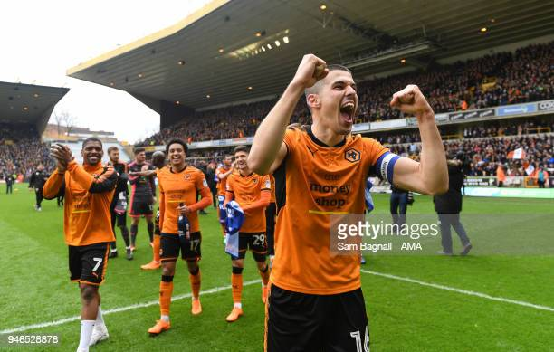 Conor Coady of Wolverhampton Wanderers celebrates promotion to the Premier League during the Sky Bet Championship match between Wolverhampton...