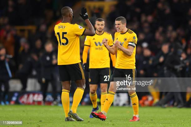 Conor Coady of Wolverhampton Wanderers celebrates with teammate Willy Boly following their sides victory in the Premier League match between...